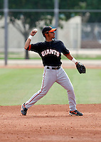Julio Izturis - San Francisco Giants - 2009 extended spring training.Photo by:  Bill Mitchell/Four Seam Images