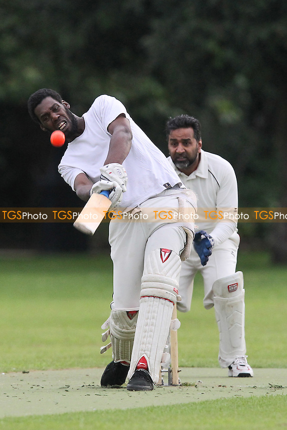 East 8 CC (fielding) vs Contenders CC - Victoria Park Community Cricket League at Victoria Park, London - 30/07/12 - MANDATORY CREDIT: Gavin Ellis/TGSPHOTO - Self billing applies where appropriate - 0845 094 6026 - contact@tgsphoto.co.uk - NO UNPAID USE.