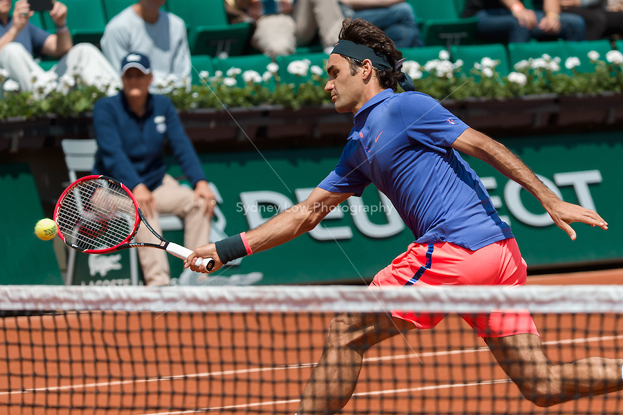 May 27, 2015: Roger Federer of Switzerland in action in a 2nd round match against Marcel Granollers of Spain on day four of the 2015 French Open tennis tournament at Roland Garros in Paris, France. Sydney Low/AsteriskImages