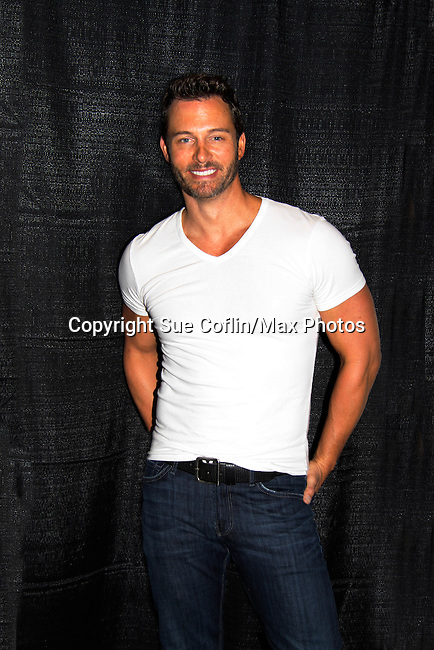 """Days of Our Lives Eric Martsolf """"Brady Black"""" appears at the 12th Annual Comcast Women's Expo on September 7 (also 6th), 2014 at the Connecticut Convention Center, Hartford, CT. He signed photos, posed with fans, walked the runway with models from Kathy Faber Designs Fashion Show, and broke some boards at Villari's Martial Arts Centers booth with Maggie and Ryan Farley.  (Photo by Sue Coflin/Max Photos)"""