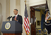 "US President Barack delivers a prime time address from the Cross Hall of the White House on September 10, 2014 in Washington, DC.  Vowing to target the Islamic State with air strikes ""wherever they exist"", Obama pledged to lead a broad coalition to fight IS and work with ""partner forces"" on the ground in Syria and Iraq.  <br /> Credit: Saul Loeb / Pool via CNP"