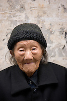 Elderly Chinese woman, aged 102, in Fuli Old Town, Xingping, China