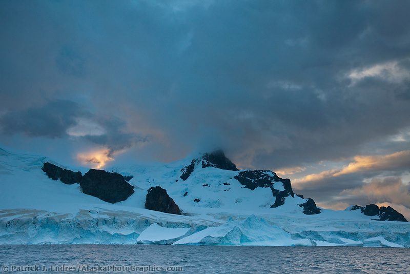 Sunset on the mountains by Cuverville Island western Antarctic Peninsula.