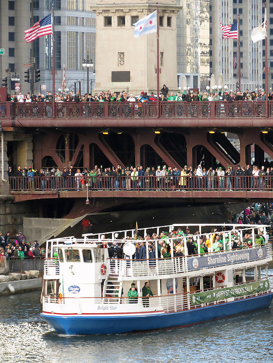 The dignitaries arrive by river cruiser before the greening of the Chicago River kicks off the 2015 St. Patrick's Day festivities in downtown Chicago. (Photo by Jamie Moncrief)