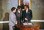 Prince Charles, right, views the Treaty of Ghent, which ended the War of 1812 between England and the United States, with Mary Means, President of the American Institute of Architects (AIA) Foundation, right, and John Busby, President-elect of the American Institute of Architects (AIA) Foundation, center, at the Octagon House in Washington, DC  on November 10, 1985.  <br /> Credit: John Ficara / Pool via CNP