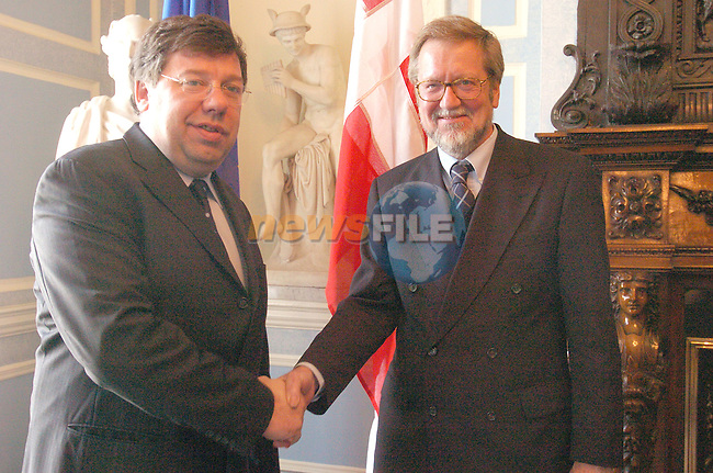Dublin Ireland, Danisk Foreign Minister Per Stig M¿ller (L) shacking hands with Irish Foreign Minister Brian Cowen (R) after there Talks on the new enlarged Europe in Iveagh house Dublin Ireland 23th April 2004..AFP Photo/Newsfile/Fran Caffrey..This Picture has been sent to you by Newsfile Ltd..The Studio,.Millmount Abbey,.Drogheda,.Co. Meath,.Ireland..Tel: +353(0)41-9871240.Fax: +353(0)41-9871260.ISDN: +353(0)41-9871010.www.newsfile.ie..general email: pictures@newsfile.ie