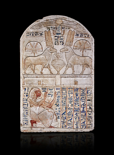 """Ancient Egyptian stele odedicated to Amon Re the """"good Ram"""" by foreman Baki, limestone, New Kingdom, 19th Dynasty, (1290-1213 BC), Deir el-Medina, Drovetti cat 1549. Egyptian Museum, Turin. black background. Reign of Ramesses II.<br /> <br /> This round-topped stele is carved in low relief and painted <br /> in several colours. The pictorial plane is divided into two <br /> registers, the upper one containing two rams facing each <br /> other. The animals, with cobras rising on their foreheads, <br /> wear tall headdresses composed of two tall plumes with a <br /> solar disk at the centre. Between them is a small offering <br /> table with lotus flowers. The mirror image hieroglyphic <br /> inscription refers to the rams and reveals their divine <br /> nature as that of Amun-Ra. In the register below, <br /> foreman Baki is shown in the pose of adoration."""