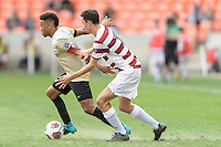 Houston, TX - Friday December 11, 2016: Jacori Hayes (8) of the Wake Forest Demon Deacons and Adam Mosharrafa (16) of the Stanford Cardinal battle for control of the ball at the NCAA Men's Soccer Finals at BBVA Compass Stadium in Houston Texas.