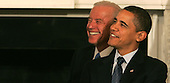 Washington, DC - February 23, 2009 -- United States President Barack Obama and Vice President Joseph Biden are all smiles before President Obama addresses the National Governors Association (NGA) in the State Dining Room of the White House on Monday, February 23, 2009. .Credit: Dennis Brack - Pool via CNP