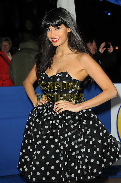 JAMEELA JAMIL .Attending the British Comedy Awards 2011 at Indigo, The O2 Arena, London.England, UK, January 22nd, 2011..arrivals half  length black and white polka dot prom dress hands on hips smiling strapless.CAP/CAS.©Bob Cass/Capital Pictures.