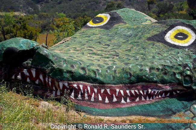 Gigantic alligator sculpture carved into rock