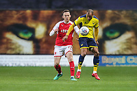 Gethin Jones of Fleetwood Town and Wes Thomas of Oxford United during the Sky Bet League 1 match between Oxford United and Fleetwood Town at the Kassam Stadium, Oxford, England on 10 April 2018. Photo by David Horn.