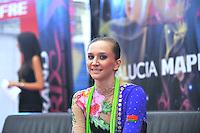 "Liubov Charkashyna of Belarus smiles from ""kiss & cry""  during event finals  at 2010 Grand Prix Marbella at San Pedro Alcantara, Spain on May 16, 2010. Liubov placed 5th AA at Marbella 2010. (Photo by Tom Theobald)."