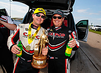 Jun 9, 2019; Topeka, KS, USA; NHRA top fuel driver Steve Torrence (left) celebrates with father Billy Torrence after winning the Heartland Nationals at Heartland Motorsports Park. Mandatory Credit: Mark J. Rebilas-USA TODAY Sports