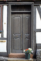 Butzbach, Germany. Wooden carved door. Photo '87.