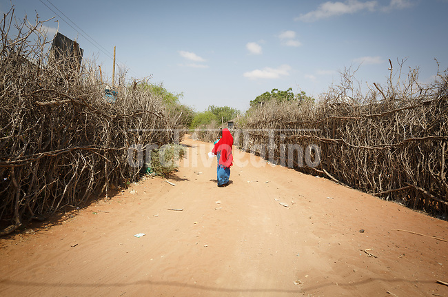 Refugee camp of Daadab in Kenya, with a population estimated in 250,000 people. Created in 1992 to host people escaping the civil conflict in Somalia, the camp under the custody of United Nations grew with waves of people escaping from civil wars and droughts. Generations are born, grown and died in this camp, considered the second largest of the World