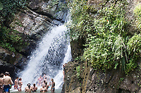 People swimming at La Mina Falls in El Yunque, a subtropical mountainous forest in Puerto Rico, which is also the only tropical rainforest in the U.S. National Forest system, on 4th January 2012.