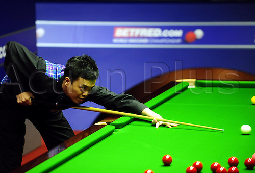 18 04 2010   Sheffield  Marco Fu of Hong Kong of China Eyes The Ball during The First Round Match Against Martin Gould of England AT The 2010 World Snooker Championship AT The Crucible Theatre in Sheffield