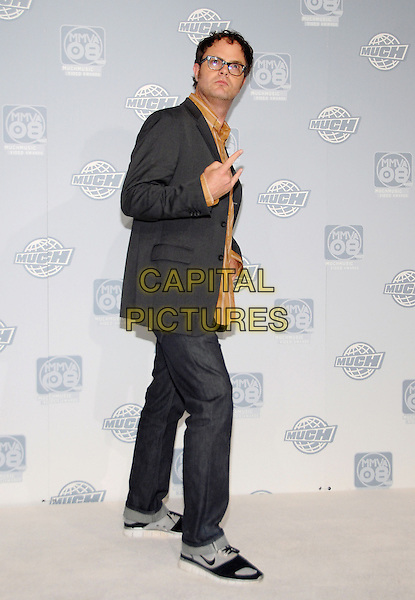 RAINN WILSON.attends the 19th Annual MuchMusic Video Awards held at Chum City Building, Toronto, Ontario, Canada, .15 June 2008..full length grey gray jacket orange striped shirt glasses jeans hand gesture.CAP/ADM/BPC.©Brent Perniac/Admedia/Capital Pictures