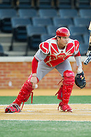 North Carolina State Wolfpack catcher Brett Austin (11) checks the runner at first after blocking a pitch in the dirt during the game against the Wake Forest Demon Deacons at Wake Forest Baseball Park on March 15, 2013 in Winston-Salem, North Carolina.  The Wolfpack defeated the Demon Deacons 12-6.  (Brian Westerholt/Four Seam Images)