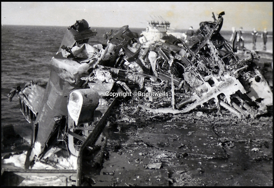 BNPS.co.uk (01202 558833)<br /> Pic: Brightwells/BNPS<br /> <br /> A Kamikaze aircraft wreckage on board the H.M.S Formidable.<br />  <br /> A remarkable photo album showing the brutal aftermath of Kamikaze attacks and crash landings on Allied aircraft carriers in the Second World War has been uncovered after 70 years.<br /> <br /> The 112 original photographs of the Royal Navy Pacific Fleet in 1945 include a host of images showing the flaming wreckage of Japanese planes that were deliberately flown into the superstructure of ships by suicidal pilots.<br /> <br /> There are also harrowing photos of US fighter planes bursting into flames on landing on the flight deck as well as one crashing into the sea.<br /> <br /> The album is being sold by Brightwells Auctioneers in Herefordshire.