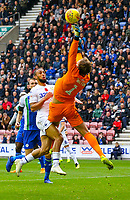 Wigan Athletic's Christian Walton gets to a cross under pressure from Leeds United's Kemar Roofe<br /> <br /> Photographer Alex Dodd/CameraSport<br /> <br /> The EFL Sky Bet Championship - Wigan Athletic v Leeds United - Sunday 4th November 2018 - DW Stadium - Wigan<br /> <br /> World Copyright &copy; 2018 CameraSport. All rights reserved. 43 Linden Ave. Countesthorpe. Leicester. England. LE8 5PG - Tel: +44 (0) 116 277 4147 - admin@camerasport.com - www.camerasport.com