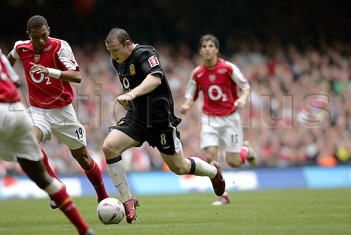 21 May 2005: Manchester United striker Wayne Rooney runs with the ball during the FA Cup Final against Man Utd. The game, played at The Millennium Stadium in Cardiff finished 0-0 after extra time, with Arsenal beating Manchester United 5-4 on penalties. Photo: Glyn Kirk/actionplus....soccer football player 050521