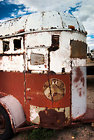 An old, rusty horse trailer sits in a vacant Shoshoni lot.