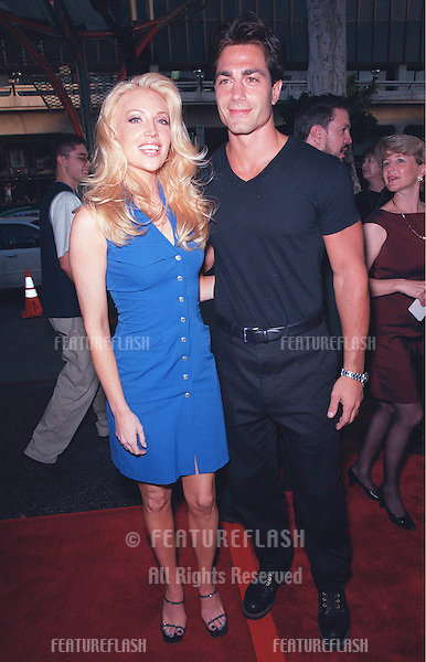 "23JUN99: Baywatch stars MICHAEL BERGIN & ANGELICA BRIDGES at the world premiere of the animated movie ""South Park: Bigger, Longer & Uncut"" at the Manns Chinese Theatre in Hollywood..© Paul Smith / Featureflash"