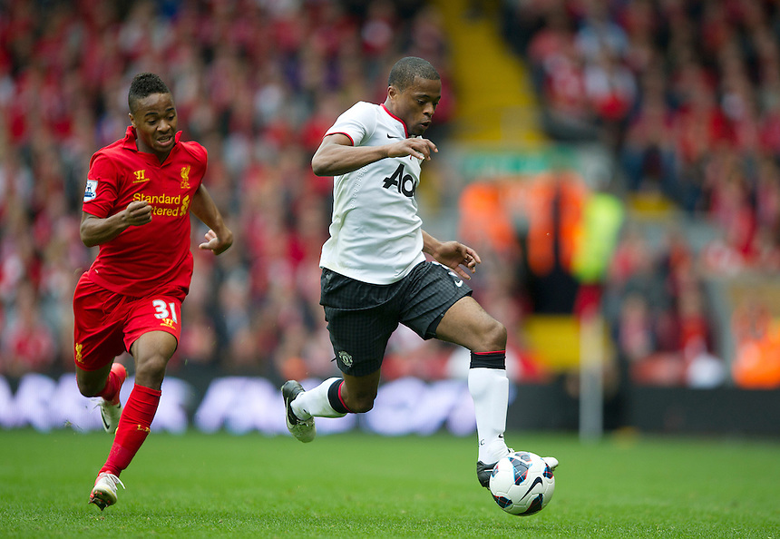 Manchester United's Patrice Evra chased by Liverpool's Raheem Sterling ..Football - Barclays Premiership - Liverpool v Manchester United - Sunday 23rd September 2012 - Anfield - Liverpool..