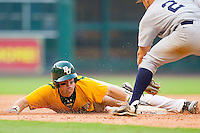Joey Hainsfurther #1 of the Baylor Bears slides head first into third base with a triple against the Rice Owls at Minute Maid Park on March 6, 2011 in Houston, Texas.  Photo by Brian Westerholt / Four Seam Images