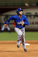 Diego Cedeno #9 of the AZL Rangers during a game against the AZL Royals at Surprise Stadium on July 15, 2013 in Surprise, Arizona. AZL Rangers defeated the AZL Royals, 3-2. (Larry Goren/Four Seam Images)