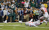 Michigan State Spartans running back Jeremy Langford (33) gets past Ohio State Buckeyes defensive back Corey Brown (3) and Ohio State Buckeyes cornerback Doran Grant (12) for the touchdown late in the 4th quarter to seal a win over Ohio State Buckeyes during the Big 10 Championship game at Lucas Oil Stadium in Indianapolis, Ind on December 7, 2013.  (Dispatch photo by Kyle Robertson)