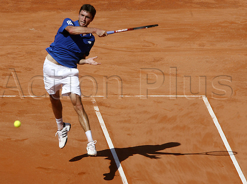 16.09.2011. Cordoba, Spain. Davis Cup tennis match. Spain versus France. Gilles SIMON smashes a forehand for France