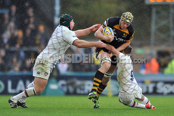 Kearnan Myall is double-tackled. Aviva Premiership match, between London Wasps and Leicester Tigers on October 27, 2013 at Adams Park in High Wycombe, England. Photo by: Patrick Khachfe / JMP