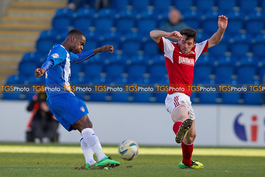 Gavin Massey of Colchester United puts a cross in despite the attemps of Brendan Moloney of Bristol City to block - Colchester United v Bristol City - Sky Bet Championship League Football Division 1 at the Weston Homes Community Stadium, Ipswich, Colchester, Essex  - 22/03/14 - MANDATORY CREDIT: Ray Lawrence/TGSPHOTO - Self billing applies where appropriate - 0845 094 6026 - contact@tgsphoto.co.uk - NO UNPAID USE
