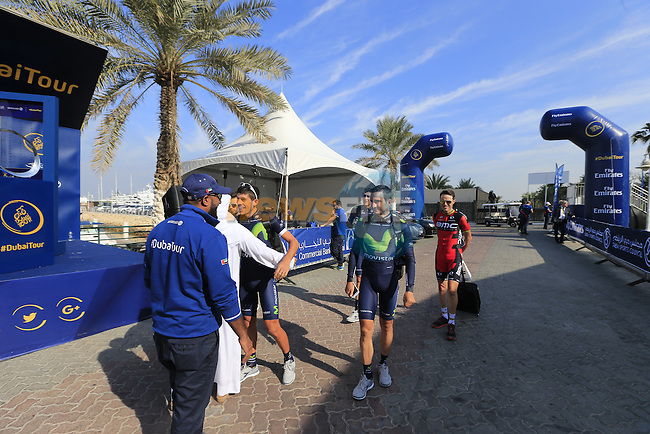 Movistar Team riders arrive for the start of Stage 1, the Dubai Silicon Oasis Stage, of the 2016 Dubai Tour starting at the Dubai International Marine Club and running 175km to Fujairah, Mina Seyahi, Dubai, United Arab Emirates. 3rd February 2016.<br /> Picture: Eoin Clarke | Newsfile<br /> <br /> <br /> All photos usage must carry mandatory copyright credit (&copy; Newsfile | Eoin Clarke)