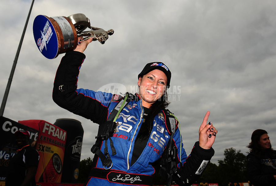 Sept. 18, 2011; Concord, NC, USA: NHRA pro mod driver Leah Pruett celebrates after winning the O'Reilly Auto Parts Nationals at zMax Dragway. Mandatory Credit: Mark J. Rebilas-
