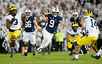 STATE COLLEGE, PA - OCTOBER 21:  Penn State QB Trace McSorley (9) jumps during a run. The Penn State Nittany Lions defeated the Michigan Wolverines 42-13 on October 21, 2017 at Beaver Stadium in State College, PA. (Photo by Randy Litzinger/Icon Sportswire)