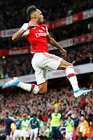 GOAL - Pierre-Emerick Aubameyang of Arsenal leaps for joy during the Premier League match between Arsenal and Aston Villa at the Emirates Stadium, London, England on 22 September 2019. Photo by Carlton Myrie / PRiME Media Images.