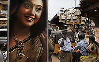 Started by shooting the exteriors of Kanishk Jewellery on Usman Road (at the busy intersection)...Moved to meet (and shoot at) Mr. Nathella Prapanna Kumar at Nathella Jewellery on South Usman Road. He is the 4th generation of the Nathella family that began this business in 1940...Also shot the flyover construction on Usman Road, with Sree Jewllery in the backdrop.  At Sree Jewellery we met Mr. Prashant Kiran (+91 98842 73999, sreejewellery@gmail.com)...Most of the evening was spent shooting at Joyalukkas on North Usman Road. We did revisit Nathella, Sree Jewellery, Kanishk Jewellery and general street scenes..Joyalukkas contact is:.Mathews Antony.mathewsalukkas@yahoo.com.044 28155655..Main contact is fixer Vinay Diddee his wife Neha made many of the arrangements..vinaydiddee@latitude.co.in.house number is +91 80 4132 0578. Vinay cell +91 98450 91377 and Neha's +91 98450 53695