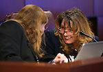 Nevada Assembly Democrats Maggie Carlton, left, and Marilyn Kirkpatrick work in committee at the Legislative Building in Carson City, Nev., on Monday, Feb. 16, 2015. <br /> Photo by Cathleen Allison