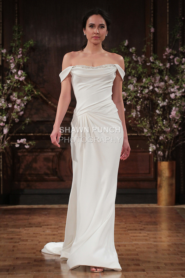 """Model walks runway in a """"Montana"""" bridal gown from the Isabelle Armstrong Spring Collection 2017, at Lotte New York Palace Hotel, during New York Bridal Fashion Week Spring Summer 2017 on April 16, 2017."""