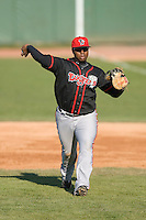 First baseman Mike McDade #40 of the Lansing Lugnuts makes a throw to home plate at Coveleski Stadium April 15, 2009 in South Bend, Indiana. (Photo by Brian Westerholt / Four Seam Images)