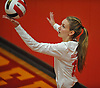 Caroline Ulrich #12 of Sacred Heart Academy serves a ball into play during a CHSAA varsity girls volleyball match against Kellenberg High School at Sacred Heart Academy in Hempstead on Tuesday, Oct. 4, 2016. Kellenberg won the match 3-0.