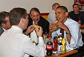 United States President Barack Obama and Russian Federation President Dmitry Medvedev enjoy the cheeseburgers and fries at Ray's Hell Burger in Arlington, Virginia, during the Russian president's visit to Washington, DC, Thursday, June 24, 2010..Credit: Martin H. Simon - Pool via CNP