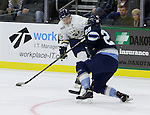 SIOUX FALLS, SD - OCTOBER 17:  Logan O'Connor #19 from the Sioux Falls Stampede looks to shoot against Alec Vanko #28 from the Madison Capitols in the first period Friday night at the Denny Sanford Premiere Center. (Photo/Dave Eggen/Inertia)