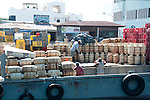 The Puerto Ayora muelle on Galapagos is getting busier and busier, because of all the imports that have to be made for the inhabitants and the tourists. Here empty gas tanks (for cooking and heating shower water) and cola crates are brought out.