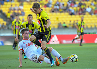 Ryan Strain tackles Michael McGlinchey during the A-League football match between Wellington Phoenix and Adelaide United at Westpac Stadium in Wellington, New Zealand on Saturday, 27 January 2018. Photo: Dave Lintott / lintottphoto.co.nz