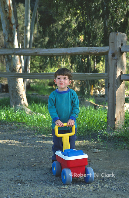 Boy with small wagon toy